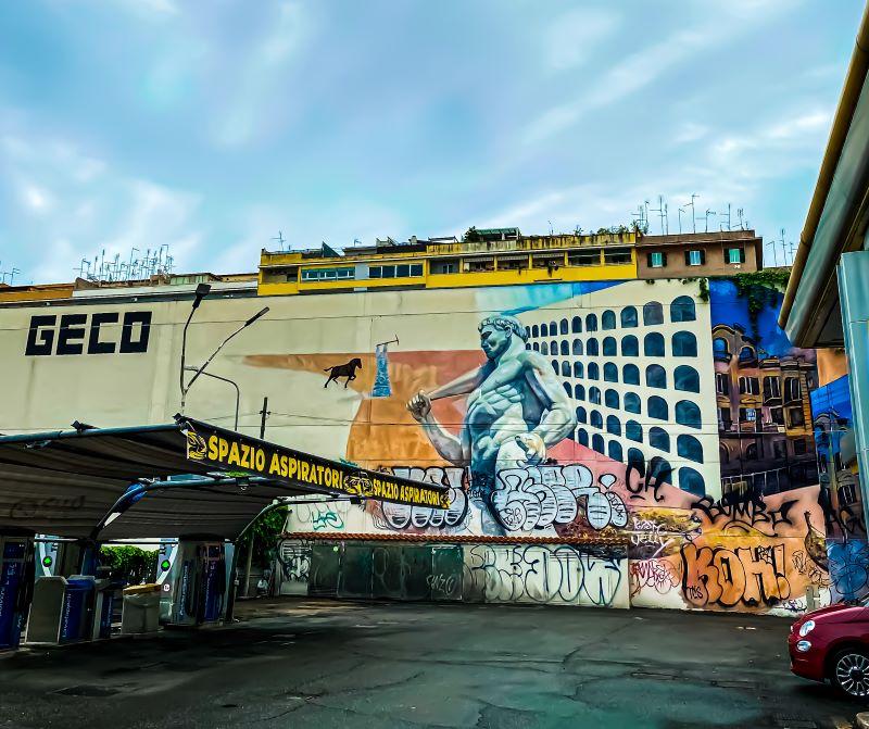 Murales di Ostiense Piccone demolitore e risanatore di GAIA